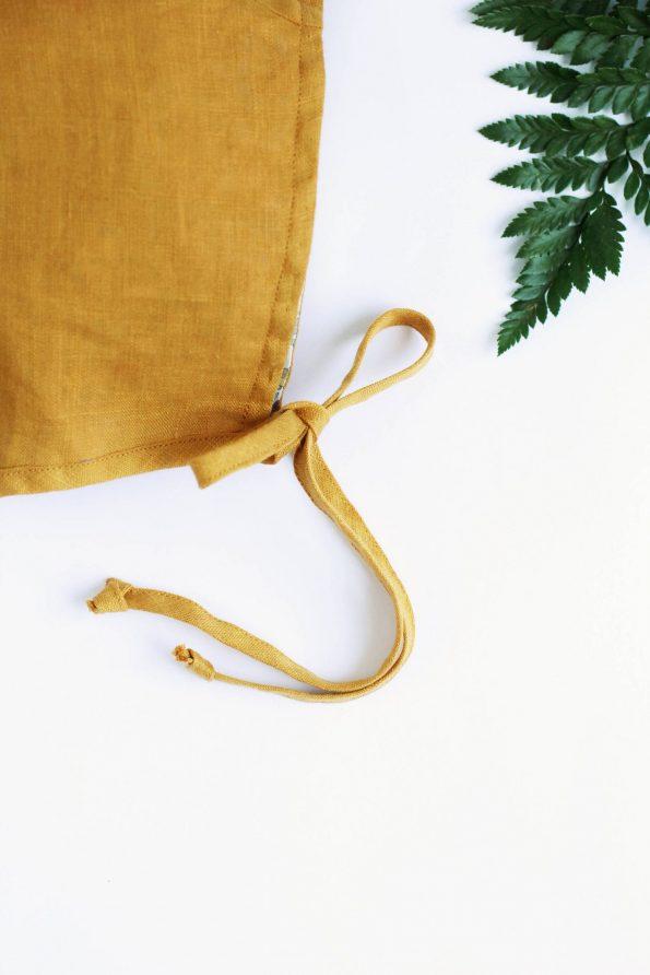 mustard-linen-baby-bonnet-close