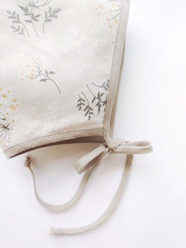 yarrow-floral-cotton-beige-linen-baby-bonnet-close
